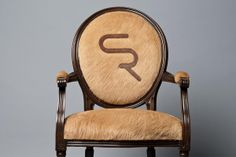 Love the branded hair on hide chair!