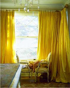 love the color and puddling of the drapes
