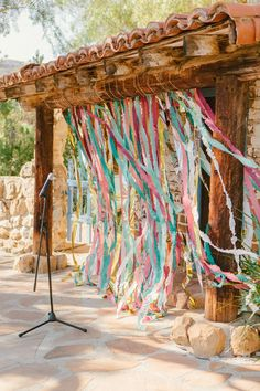 streamer backdrops, photo by The Melideos http://ruffledblog.com/leo-carrillo-ranch-wedding #ceremonies #backdrop #streamers