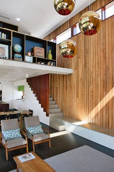 2. Into the voidWith its spherical Tom Dixon 'Copper' pendant lights, the void over the living area...