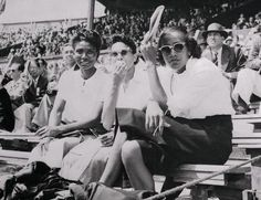 I am saddened to learn that Alice Coachman, the first Black woman to win a gold medal at the Olympic Games (London 1948 for the high jump) died today at the age of 90 near her home in Albany, Georgia. In this photo, Ms. Coachman (far right) takes a break and watches the 1948 London games with fellow athletes Emma Reed, of Nashville, Tennessee (broad and high jumper) and Nell C. Jackson, of Tuskegee, Alabama, (200 meters and relay. Photo: Bettman/Corbis.