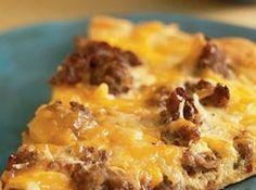 Breakfast Pizza Recipe; sausage, bacon, cheddar, hash browns, eggs milk, pizza crust mix.