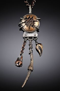 Pendant | Una Barrett. 'Keeper of the Secrets'.  Sterling silver, copper, bronze