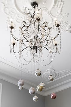Ornaments hanging from chandelier.  #IntDesignerChat