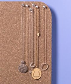 A cork or bulletin board is the easiest way to organize a collection of necklaces.