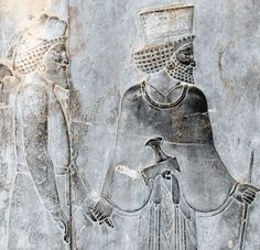 Tribute Bearer and Achaemenid Guide on the Apadana Staircase.  The Apadana palace was built by Darius in the western side of Persepolis, which was used by the king for official audiences. Work was began in 515 BCE, with his son Xerxes I completing it 30 years later. Persepolis was the ceremonial capital of the Achaemenid Empire, and is situated in Iran.  Photo courtesy & taken by A.Davey.