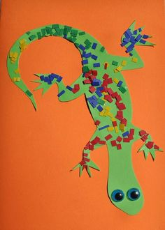 """Mosaic Lizard: These bright lizard pictures look great pinned on the kitchen fridge.  And they are so straightforward to produce that with a little preparation toddlers and preschoolers will have no trouble with this activity. A great project for a """"Letter L"""" theme in the classroom - or a quick and easy activity to entertain your little artist."""