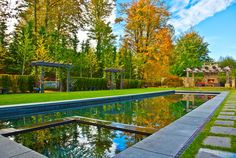 A spectacular outdoor, rectangular, pool and spa. It is situated beautifully among perfectly manicured ground and nature's beauty. Sammamish, WA Coldwell Banker BAIN