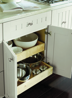 Pull-out drawers are the best way to store heavy and large bowls and pots.