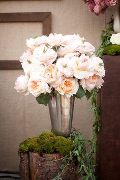 Peach peonies in silver vase