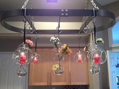 My pot rack makeover -- in progress. I love the CB2 whirlys and three-ball vases, but I'm not crazy about what's in 'em.