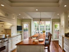 Green Kitchen. Love the island and all of the natural light with white and hardwood. LOVE!!!