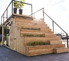 Shipping container house....stairs leading to the roof top terrace nice look for garden storage or a green-house with exposure on one side.  Possibilities...