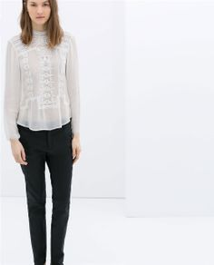 Image 1 of EMBROIDERED BLOUSE WITH A HIGH COLLAR from Zara