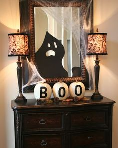 """I do the """"BOO"""" every year on pumpkins for outside at my & my daughter's homes but this is cute and really love the mirror ghost."""