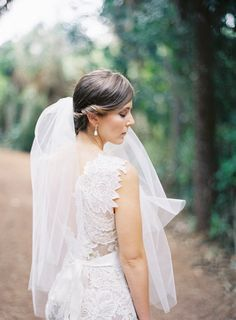 beautiful Bride in her http://www.ulla-maija.com/ gown and that veil!  Photography by jessicalorren.com