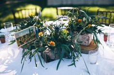 whimsical organic centerpieces with vintage postcards