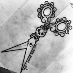 This would be a cool tattoo for a hair stylist, love the girly skull detail.