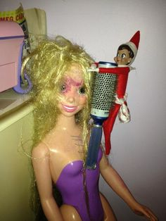 From the Elf on the Shelf Gallery:  Mary the Elf tries her best as a stylist. #elfontheshelf #elfontheshelf
