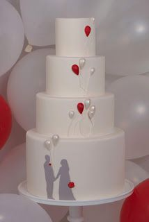 Love this unique wedding cake!  Silhouette of the couple with balloons as accent colors!