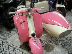 Pink Vespa with side car.