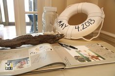 Nautical themed guest book filled with photos of the happy couple