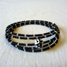 Memory wire bracelets - small beads w/1 large bead