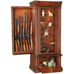 long guns in secret compartment of curio cabinet