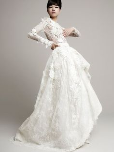 Top Wedding Dress Trends for 2014   Floral Details - Yolan Cris http://chicvintagebrides.com/index.php/wedding-dresses/top-10-wedding-dress-trends-2014/