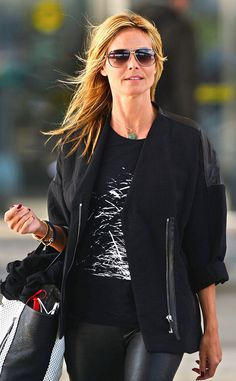 Heidi Klum looked effortlessly chic (as always) in an all-black get-up, paired with subtly color-blocked aviator shades!