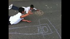 K-4th Grade Interactive Chalk Drawings by Suzanne Tiedemann. K-4th grade students created these interactive chalk drawings on their last days of art class.  Their objective was to draw a scene that they could then become a part of.  They had the option of working alone or with others.