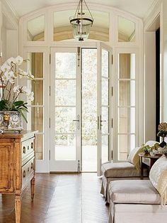 orchids in the entry~ beautiful white wookwork