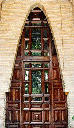 unique door, antoni gaudi, arch, window, stylish door, interesting doorways, wooden doors, barcelona spain, wood doors