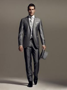 Short morning dress in wool and silk, plain colour with a shiny effect, peak lapels, silver grey with pearl grey waistcoat. Striped trousers without pleats, 20 cm base. #formalwear13 #men