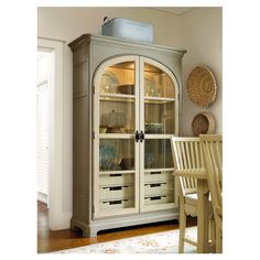 """Montgomery Pantry from Joss and Main. Featuring 2 glass doors and an oyster shell finish, this versatile wood pantry adds farmhouse inspired style to your decor. Made of cherry veneers and select hardwood solids. Features 3 lighted shelves and 6 drawers. 83""""H x 55""""W x 20""""D. $1300.95"""