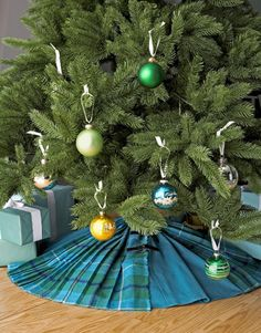 Plaid Tree Skirt:   A literal take on the Christmas tree skirt, this resourceful project makes clever use of old clothes in your closet. Sew together panels from two skirts in complementary colors to make a similar decoration.   Photo Credit: Lara Robby/Studio D