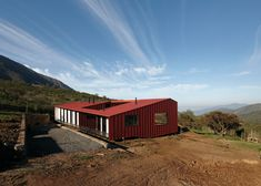Architecture studio MAPA borrowed elements and colours typically used on colonial-style Chilean houses to create this bright red residence in a winemaking region near Santiago.