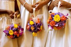 Three young flowergirls holding yellow, orange and purple kissing ball bouquets. ball bouquet, idea, flower ball, fall flowers, balls, kiss ball, wedding bouquets, bridesmaid bouquets, flower girls