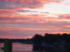 """Highland Township resident Lynda Scullion captured this shot of a sunrise over White Lake in July 2008. Scullion wrote: """"I believe this photo is very representative of Oakland County as White Lake at sunrise is indicative of all the lakes available in our county."""""""