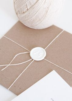 white wax seal.  We have white wax and wax impression seals at FOUND.  Add some brown paper and string for this look.