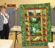 Glenna Jones with an attic window quilt made with a printed panel.