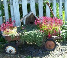 Welcome Wagon Planter birdhouses, garden junk, garden art, front yards, gardens, red wagon, planter, flower beds, old wagons