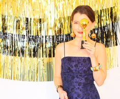 How to make a cute photo booth backdrop for your Awards Show Party on www.KellyGolightly.com