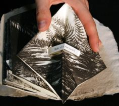 """The Forest Perilous : Michelle Wilson. Handmade paper cover, pulp painting, lithograph, and letterpress, edition of 8.  This book explores the idea of narrative transformation through the metaphor of a journey through a forest at night. Printed on the reverse of a Turkish Map fold, this structure creates """"secret pages,"""" between the folds, where the story is revealed."""