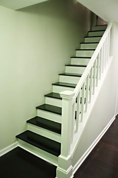 idea for the stairs - open/railing, wood stairs (lighter wood) with a runner down the center