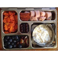 Carrot chips, blueberries, grapes, sandwich roll ups, cottage cheese and a fruit stick