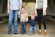 family, family of four, family photos, dad and sons, siblings, kids, first birthday photography, boy, son, one year old, sons, boys, father and son photos, mom and sons, bridge, feet, shoes, legs
