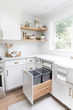 Pull-out kitchen trash can cabinet with two trash bins AND a built-in paper towel holder - I need this in my new kitchen! #kitchenremodel #kitchenorganization #kitchenrenovation
