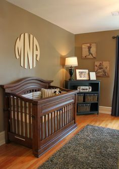 Boy nursery. Pinning this because I never thought a monogram over the crib could look this masculine. Awesome!