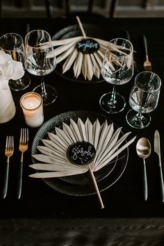 Celestially inspired wedding place settings with dried sun spear palm leaves as unique placemats and starry constellations for place cards #placesetting #weddingdecor #celestialwedding #palmleaves #driedflowers #placemats #weddingideas #wedding #weddingdecor #weddingreception
